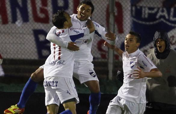 Viudez of Uruguay's Nacional is congratulated by teammates after scoring against Peru's Alianza Lima in Montevideo