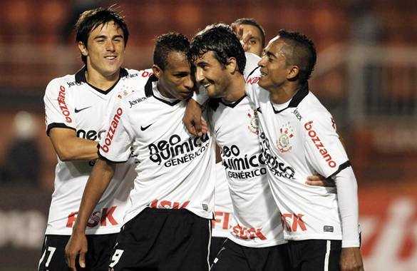 Douglas of Brazil's Corinthians celebrates his goal against Venezuela's Deportivo Tachira with his team mates during their Copa Libertadores soccer match in Sao Paulo