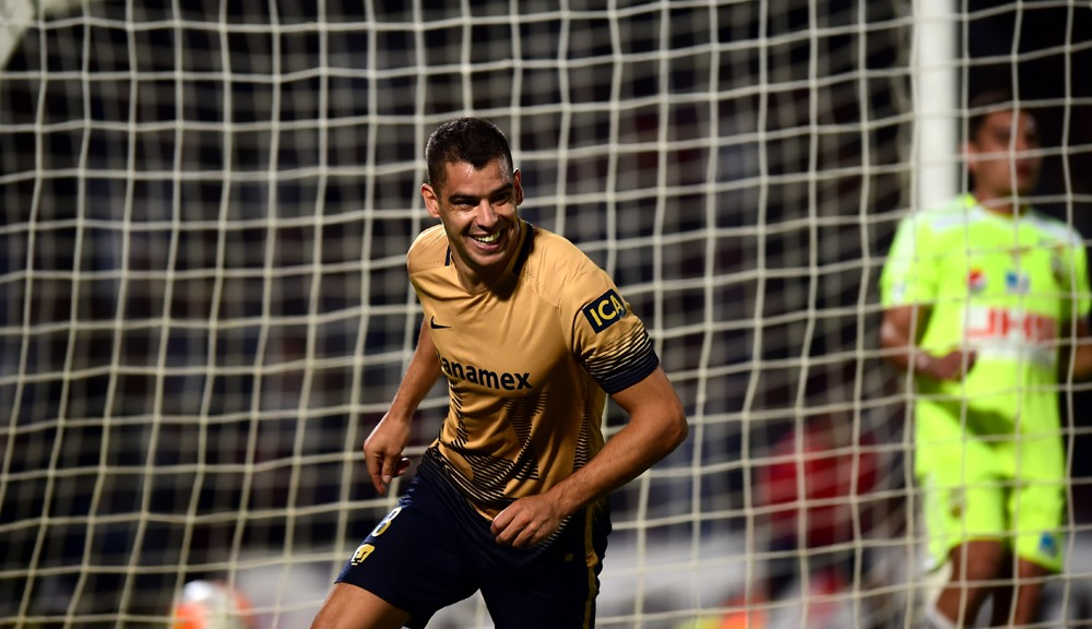 Gerardo Alcoba of Mexico's Pumas celebrates his goal against Venezuela´s Deportivo Tachira, during their Copa Libertadores 2016 tournament football match at Universitario stadium in Mexico city, on March 17, 2016.  / AFP / RONALDO SCHEMIDT        (Photo credit should read RONALDO SCHEMIDT/AFP/Getty Images)