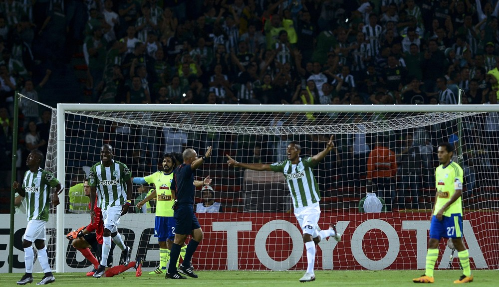 Jonathan Copete (C) of Colombia's team Atletico Nacional celebrates after scoring against Peru's Sporting Cristal during a Libertadores Cup 2016 group 4 football match at the Atanasio Girardot stadium in Medellin, Antioquia department, Colombia, on March 1, 2016. AFP PHOTO / RAUL ARBOLEDA / AFP / RAUL ARBOLEDA        (Photo credit should read RAUL ARBOLEDA/AFP/Getty Images)