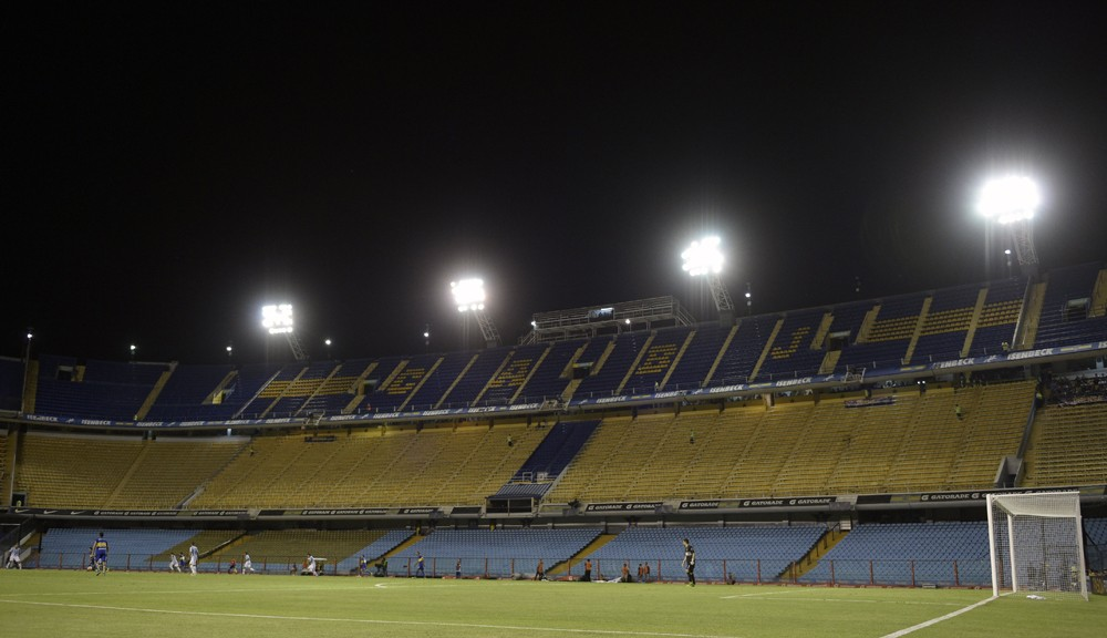 "Partial view of the empty stadium during the Copa Libertadores 2016 group 3 football match between Argentina's Boca Juniors and Racing Club at the ""Bombonera"" stadium in Buenos Aires, Argentina, on March 3, 2016. Boca was fined by CONMEBOL to play two matches without supporters after the suspended match against River Plate during the 2015 torunament edition. AFP PHOTO / JUAN MABROMATA / AFP / JUAN MABROMATA        (Photo credit should read JUAN MABROMATA/AFP/Getty Images)"