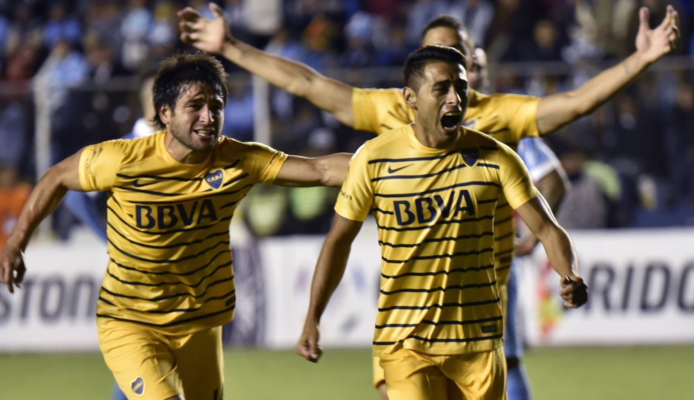 Footballer Federico Carrizo (R) of Argentina's Boca Juniors, celebrates with teammates after scoring against Bolivia's Bolivar during their Libertadores Cup match at the Hernando Siles stadium in La Paz, on March 10, 2016.   AFP PHOTO / AIZAR RALDES / AFP / AIZAR RALDES        (Photo credit should read AIZAR RALDES/AFP/Getty Images)