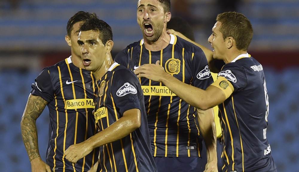 Alejandro Donatti (C), of Argentina's Rosario Central celebrates with teammates after scoring against Uruguay's River Plate during their Libertadores Cup football match at the Centenario Stadium  in Montevideo on March 17, 2016.  AFP PHOTO / MIGUEL ROJO / AFP / MIGUEL ROJO        (Photo credit should read MIGUEL ROJO/AFP/Getty Images)