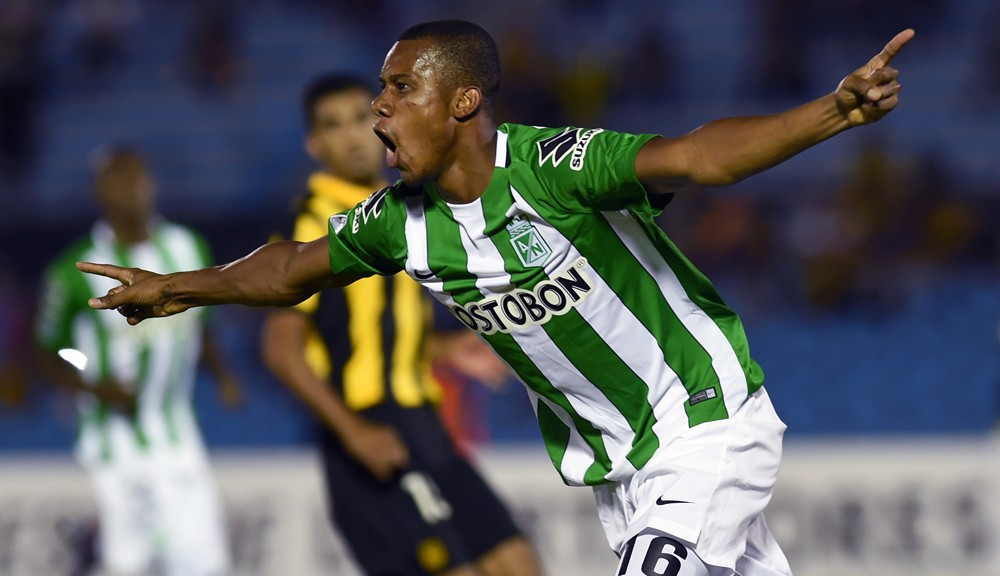 Footballer Jonathan Copete of Colombia's team Atletico Nacional celebrates after scoring against Uruguay's Penarol during their Libertadores Cup football match at the Centenario Stadium in Montevideo on March 15 , 2016. AFP PHOTO / MIGUEL ROJO / AFP / MIGUEL ROJO        (Photo credit should read MIGUEL ROJO/AFP/Getty Images)