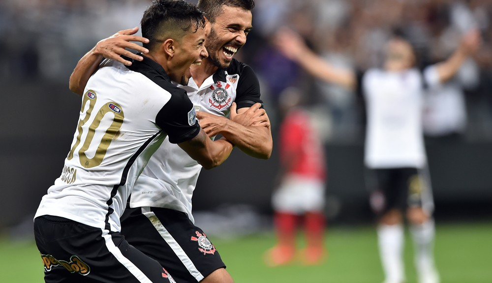 Lucca (L) and Uendel (R) of Brazils Corinthians celebrate an own goal scored by Victor Mareco (not in frame) of Paraguay's Cerro Porteno during their 2016 Copa Libertadores football match at Arena Corinthians stadium, in Sao Paulo, Brazil, on March 16, 2016. AFP PHOTO / Nelson ALMEIDA / AFP / NELSON ALMEIDA        (Photo credit should read NELSON ALMEIDA/AFP/Getty Images)