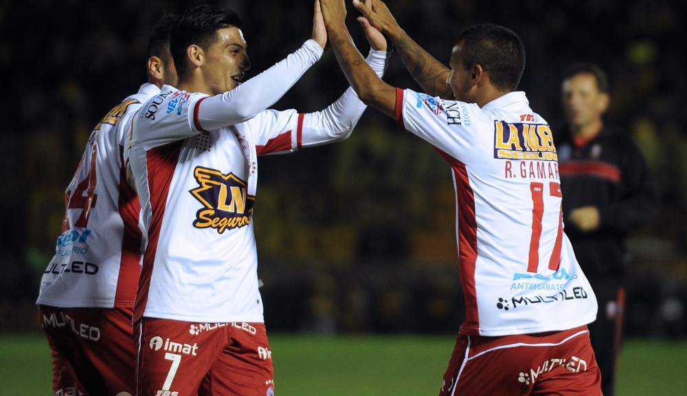 Romero Gamarra (R) of Argentine team Huracan celebrates with teammate Omar Espinoza after scoring against Uruguay's Penarol during their Libertadores Cup football match at the Centenario Stadium in Montevideo on March 1, 2016.   AFP PHOTO / MIGUEL ROJO / AFP / MIGUEL ROJO        (Photo credit should read MIGUEL ROJO/AFP/Getty Images)