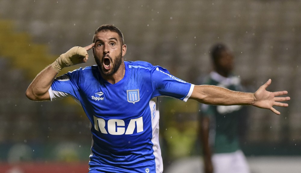 Argentine Racing Club forward Lisandro Lopez celebrates his goal against Colombia's Deportivo Cali during their Copa Libertadores 2016 tournament football match at Deportivo Cali stadium, in Palmira, Colombia, on March 17, 2016. AFP PHOTO / LUIS ROBAYO / AFP / LUIS ROBAYO        (Photo credit should read LUIS ROBAYO/AFP/Getty Images)