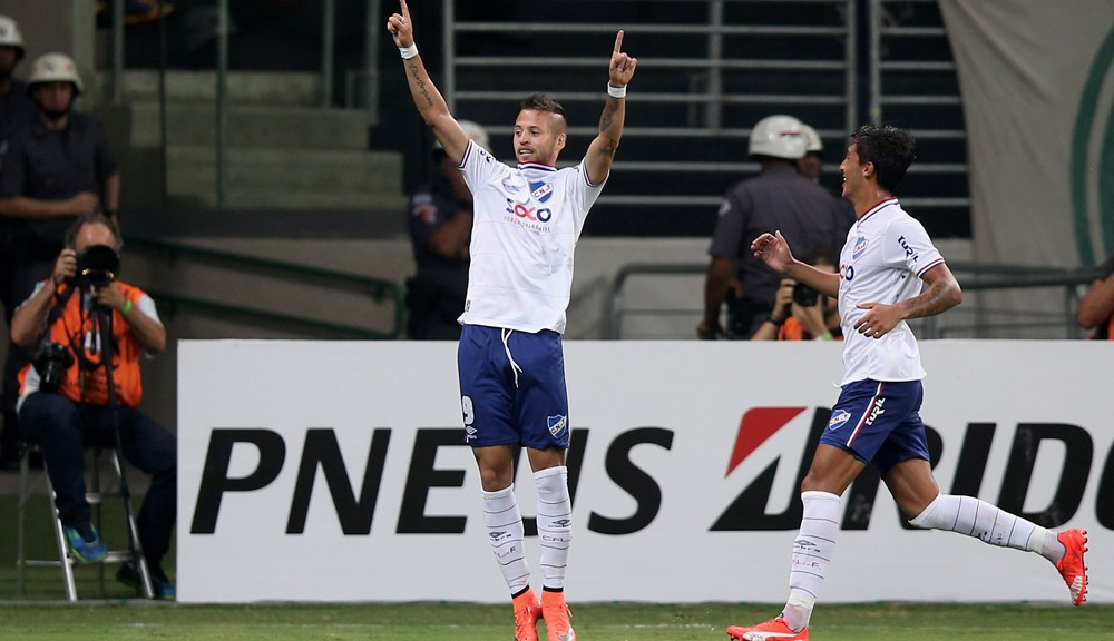 SAO PAULO, BRAZIL - MARCH 09:  Nicolas Lopez (L) of Nacional celebrates scoring the first goal during a match between Palmeiras and Nacional as part of Group 2 of Copa Bridgestone Libertadores at Allianz Parque on March 9, 2016 in Sao Paulo, Brazil.  (Photo by Friedemann Vogel/Getty Images)