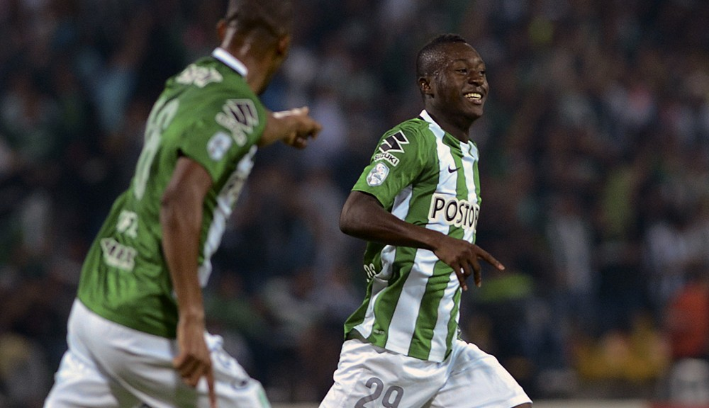 Colombia's Atletico Nacional player Marlos Moreno (R) celebrates with teammates after scoring a goal against Uruguay's Penarol during the Copa Libertadores 2016 group 4 football match at the Atanasio Girardot stadium in Medellin, Antioquia department, Colombia on March 8, 2016. AFP PHOTO/Raul ARBOLEDA / AFP / RAUL ARBOLEDA        (Photo credit should read RAUL ARBOLEDA/AFP/Getty Images)