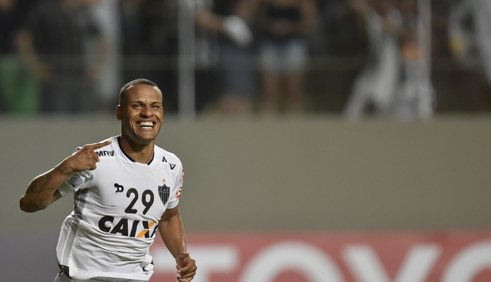 Patric of Brazil's Atletico Mineiro celebrates after scoring against Chile's Colo-Colo during their 2016 Libertadores Cup match at the Independencia stadium in Belo Horizonte, Brazil on March 16, 2016.   AFP PHOTO / Douglas MAGNO / AFP / Douglas Magno        (Photo credit should read DOUGLAS MAGNO/AFP/Getty Images)