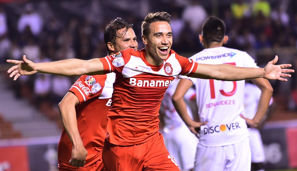 Footballer Carlos Rodriguez of Mexico's team Toluca celebrates after scoring against Ecuador's Liga de Quito during their Libertadores Cup match at Casa Blanca stadium in Quito, on March 10, 2016.  AFP PHOTO / RODRIGO BUENDIA / AFP / RODRIGO BUENDIA        (Photo credit should read RODRIGO BUENDIA/AFP/Getty Images)