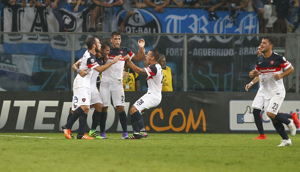 PORTO ALEGRE, BRAZIL - MARCH 09: Players of San Lorenzo celebrate their first goal during the match Gremio v San Lorenzo as part of Copa Bridgestone Libertadores 2016, at Arena do Gremio  on March 09, 2016 in Porto Alegre, Brazil. (Photo by Lucas Uebel/Getty Images)
