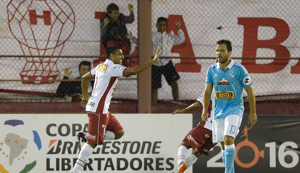 Argentinas Huracan player forward Ramon Abila (L) celebrates upon scoring against Perus Sporting Cristal during their Copa Libertadores group 4 football match at Tomas Duco stadium in Buenos Aires, Argentina, on April 5, 2016.  / AFP / EITAN ABRAMOVICH        (Photo credit should read EITAN ABRAMOVICH/AFP/Getty Images)