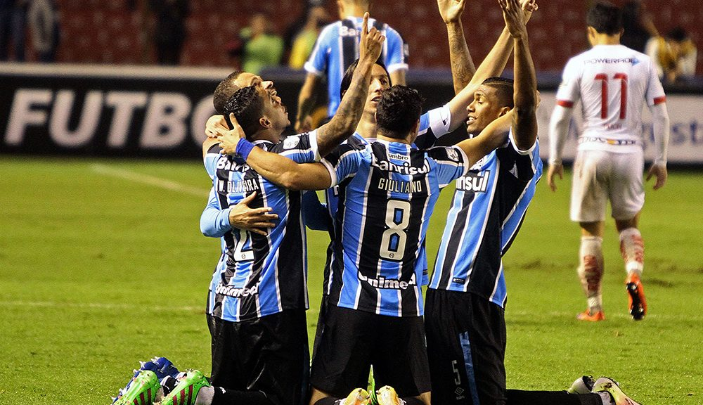 Brazil's Gremio players celebrate after scoring a goal against Ecuador's Liga Deportiva Univesitaria de Quito team, during the Libertadores football match at Casa Blanca stadium on April 13, 2016, in Quito, Ecuador.    / AFP / JAVIER CAZAR        (Photo credit should read JAVIER CAZAR/AFP/Getty Images)