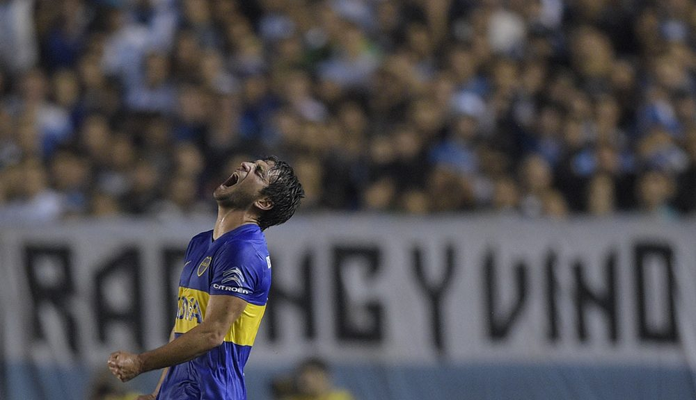 Argentina's Boca Juniors midfielder Nicolas Lodeiro celebrates after scoring against Argentina's Racing Club during the Copa Libertadores 2016 group 3 football match at Juan Domingo Peron stadium in Avellaneda, Buenos Aires, Argentina, on April 13, 2016.  / AFP / EITAN ABRAMOVICH        (Photo credit should read EITAN ABRAMOVICH/AFP/Getty Images)
