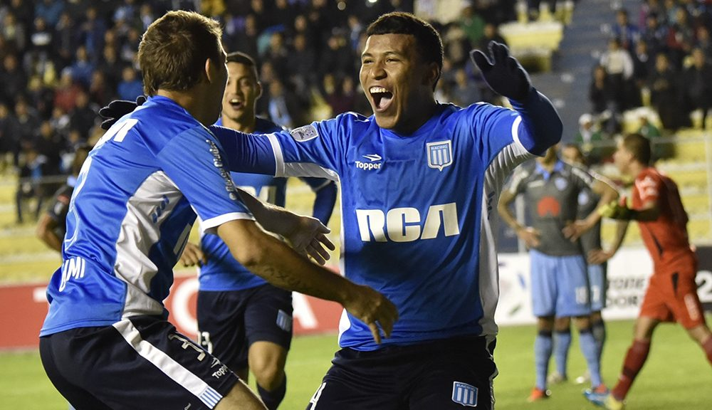 Rogers Martinez (R), of Argentina's Racing Club celebrates after scoring against Bolivia's Bolivar, during their Copa Libertadores football match at Hernando Siles stadium in La Paz Bolivia, on April 20, 2016. / AFP / AIZAR RALDES        (Photo credit should read AIZAR RALDES/AFP/Getty Images)