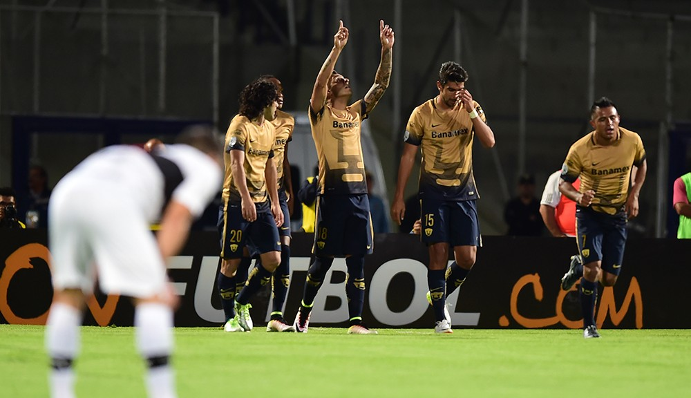 Players of Mexico's Pumas celebrate a goal against Paraguay's Olimpia during their Libertadores 2016 Cup football match at the Universitario Stadium in Mexico City on April 6, 2016.  / AFP / RONALDO SCHEMIDT        (Photo credit should read RONALDO SCHEMIDT/AFP/Getty Images)