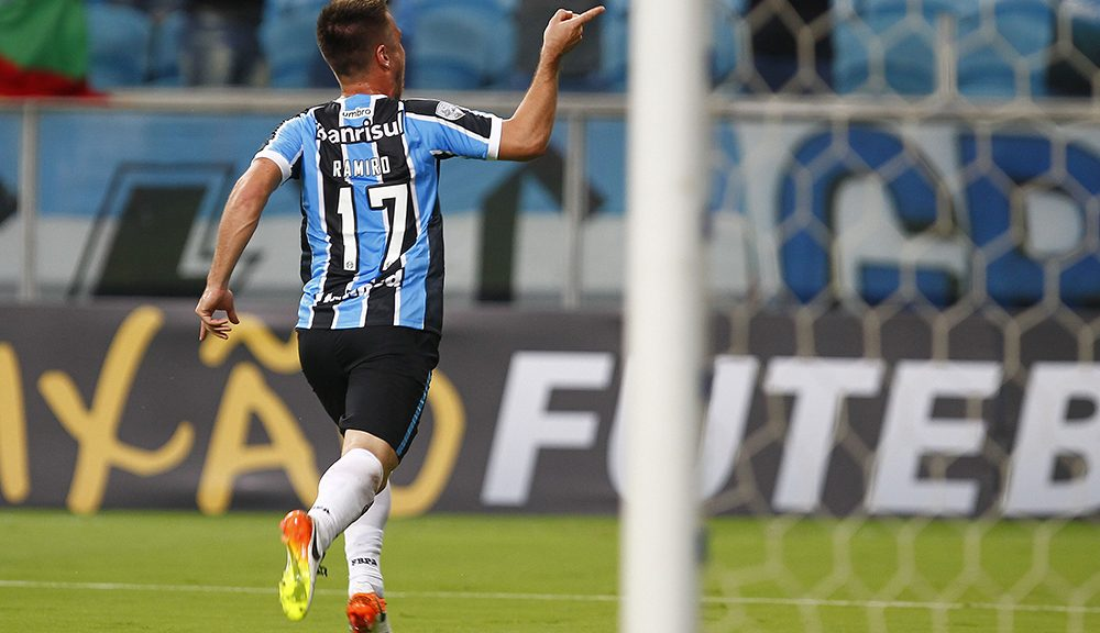 PORTO ALEGRE, BRAZIL - APRIL 19: Ramiro player of Gremio celebrates their first goal during the match Gremio v Toluca as part of Copa Bridgestone Libertadores 2016, at Arena do Gremio  on April 19, 2016 in Porto Alegre, Brazil. (Photo by Lucas Uebel/Getty Images)