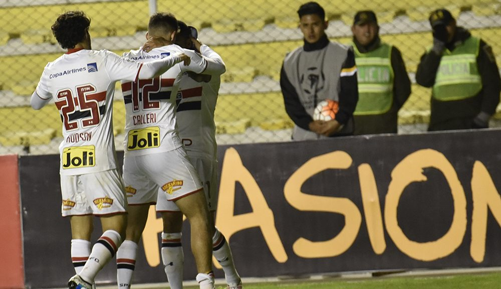Jonathan Calleri (C), of Brazil's Sao Paulo, celebrates with teammates after scoring against Bolivia's The Strongest during their Copa Libertadores football match at Hernando Siles stadium, in La Paz Bolivia, on April 21, 2016.  / AFP / AIZAR RALDES        (Photo credit should read AIZAR RALDES/AFP/Getty Images)