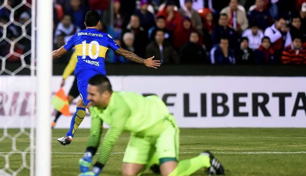 Argentina's Boca Juniors player Carlos Tevez celebrates after scoring against Paraguay's Cerro Porteno during their Libertadores 2016 Cup football match at Defensores del Chaco stadium, in Asuncion, on April 28, 2016 / AFP / PABLO BURGOS        (Photo credit should read PABLO BURGOS/AFP/Getty Images)