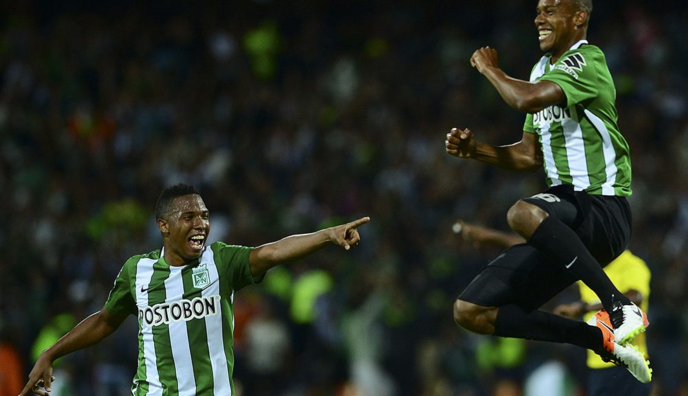 Colombia's Atletico Nacional player Jonathan Copete (R) celebrates with teammates after scoring against Argentina's Huracan during their Copa Libertadores 2016 football match at Atanasio Girardot  stadium in Medellin, Antioquia department, Colombia, on May 3, 2016. / AFP / RAUL ARBOLEDA        (Photo credit should read RAUL ARBOLEDA/AFP/Getty Images)