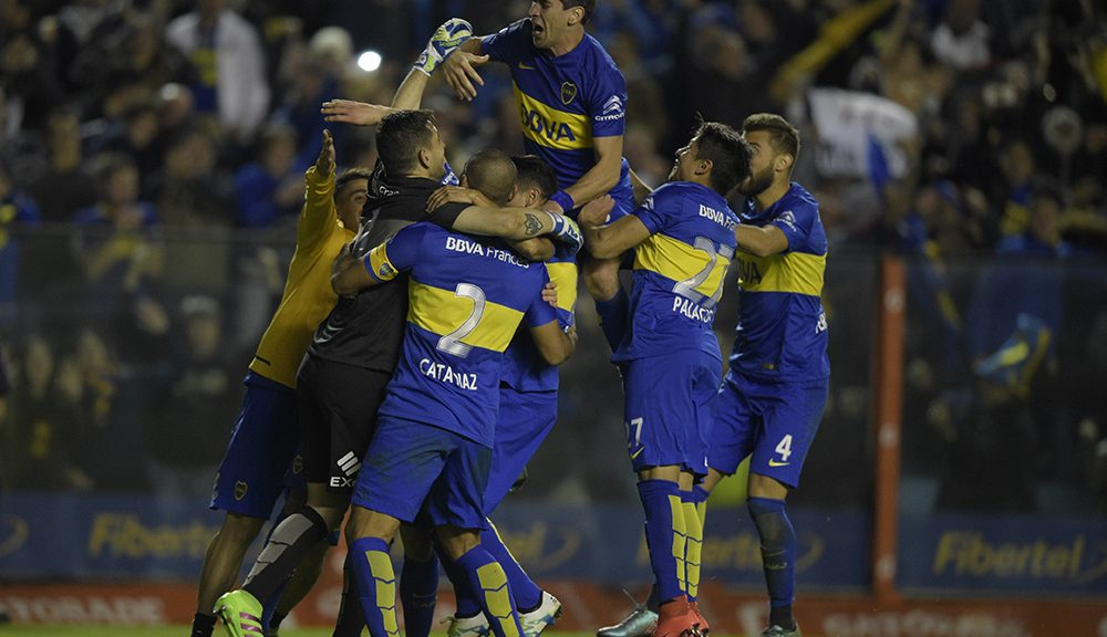 "Argentina's Boca Juniors forward Federico Carrizo (11) celebrates with teammates after scoring the winning penalty during the shoot-out against Uruguay's Nacional during their Libertadores Cup quarterfinal second leg football match at the ""Bombonera"" stadium in Buenos Aires, on May 19, 2016. / AFP / EITAN ABRAMOVICH        (Photo credit should read EITAN ABRAMOVICH/AFP/Getty Images)"