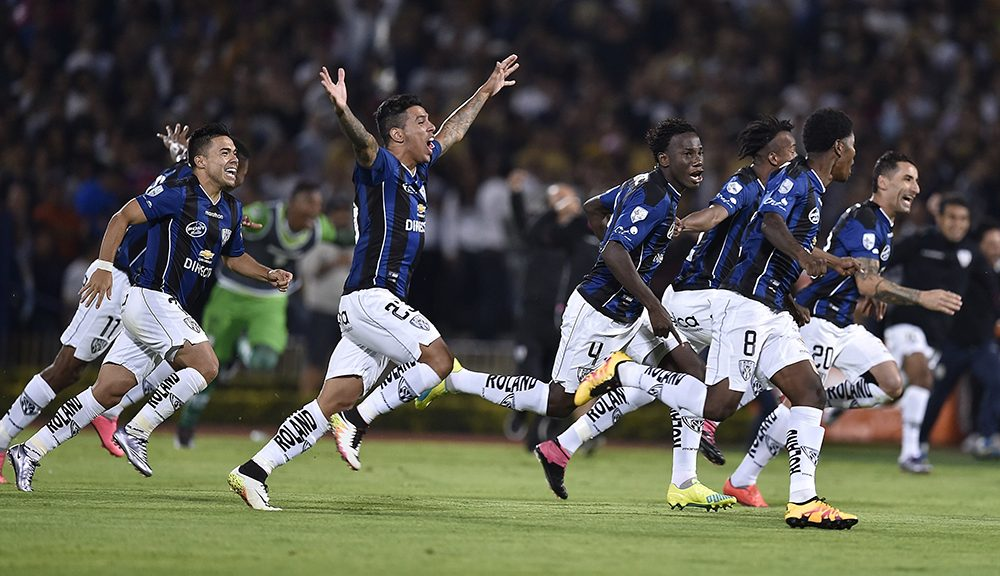 Players of   Independiente del Valle of Ecuador celebrate at the end of a penalty kick series against Mexico's Pumas, during their Copa Libertadores 2016 tournament quarterfinal football match at the Olympic stadium on May 24, 2016, in Mexico City. Independiente del Valle passed to semifinals. / AFP / OMAR TORRES        (Photo credit should read OMAR TORRES/AFP/Getty Images)