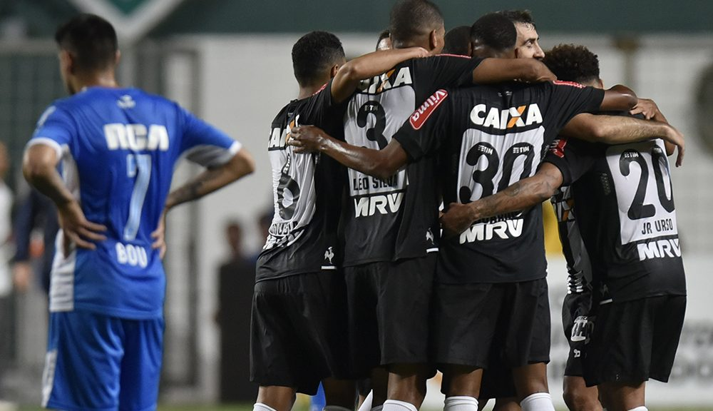 Brazil's Atletico Mineiro players celebrate during their 2016 Libertadores Cup football match against Argentinian Racing at the Independencia Stadium in Belo Horizonte, Brazil on May 4, 2016. / AFP / DOUGLAS MAGNO        (Photo credit should read DOUGLAS MAGNO/AFP/Getty Images)
