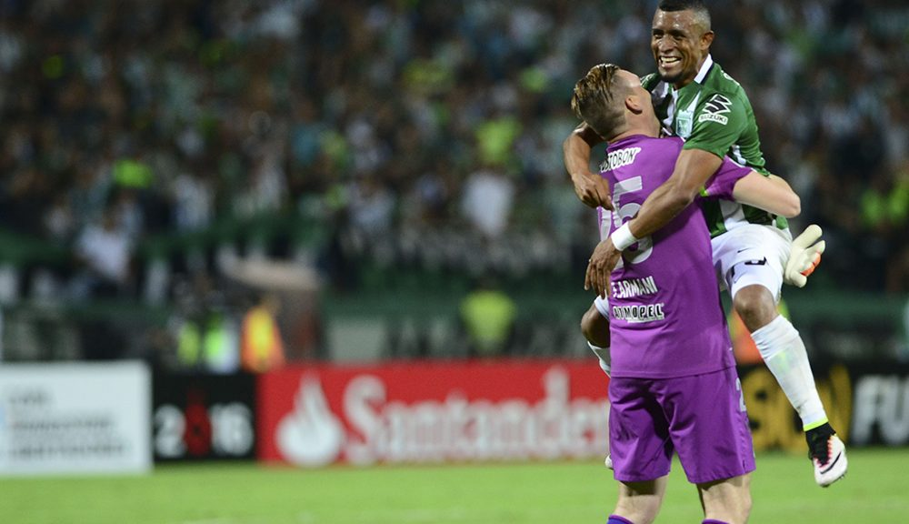 Colombia's Atletico Nacional goalkepeer Franco Armani (L) celebrates with Farid Diaz at the end of his match against Argentina's Rosario Central  during the Copa Libertadores 2016  football match at Atanasio Girardot  stadium in Medellin, Antioquia department, Colombia, on May 19, 2016. / AFP / RAUL ARBOLEDA        (Photo credit should read RAUL ARBOLEDA/AFP/Getty Images)
