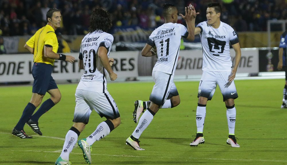 Pumas' Fidel Martínez (#20)  celebrates after scoring against Independiente del Valle, during their Libertadores Cup football match at  at Atahualpa Stadium in Quito on, May 17, 2016 / AFP / JUAN CEVALLOS        (Photo credit should read JUAN CEVALLOS/AFP/Getty Images)